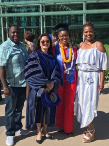 Capstone mentee and class of 2018 graduate, Shania Davis with her parents.